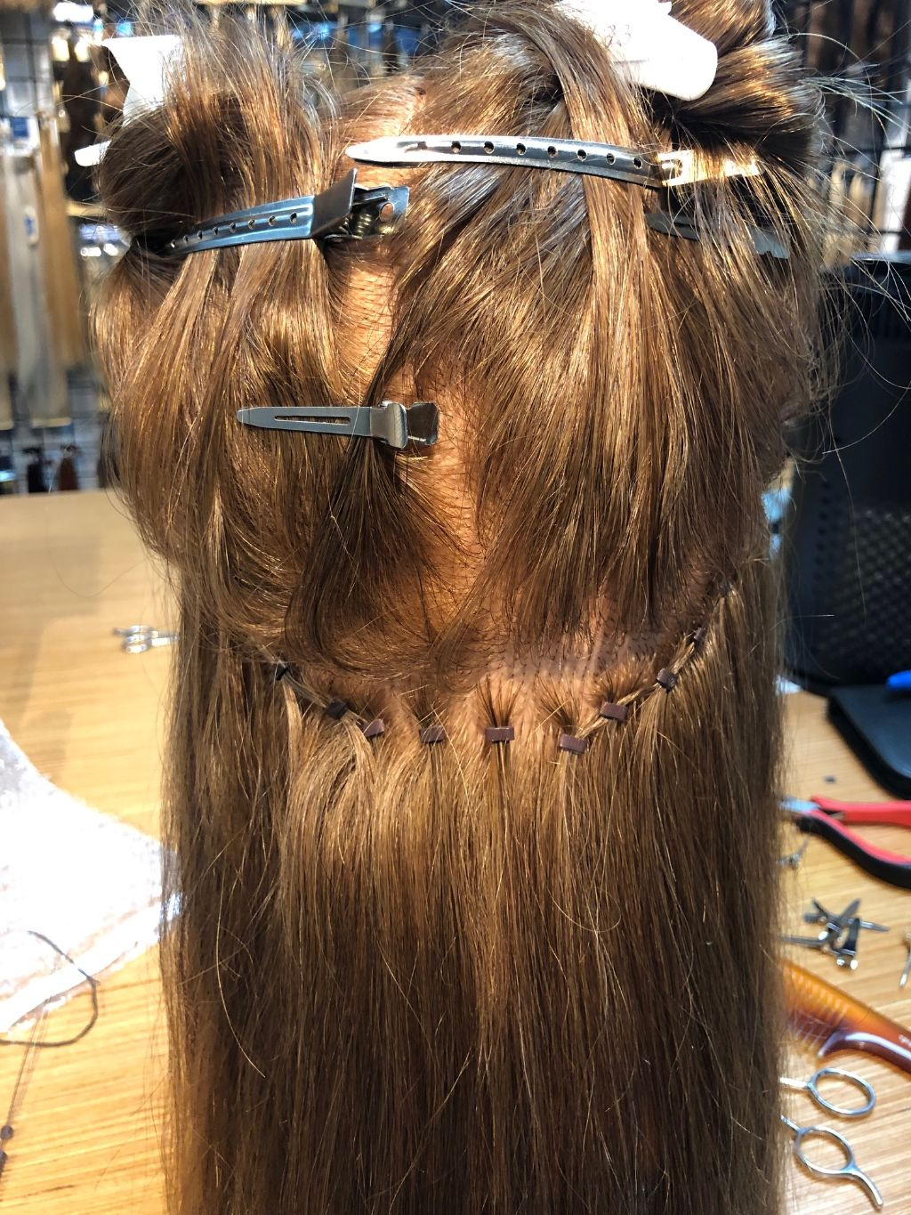 Nape section of Beaded row, Hand Tied, hair extension application
